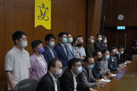 Hong Kong's pro-democracy legislators attend a press conference at the Legislative Council in Hong Kong, Monday, Nov. 9, 2020. The lawmakers said Monday that they would resign en masse if Beijing disqualifies any of them. The announcement came amid unconfirmed reports that Beijing would oust four legislators for filibustering meetings and violating their oath. (AP Photo/Vincent Yu)