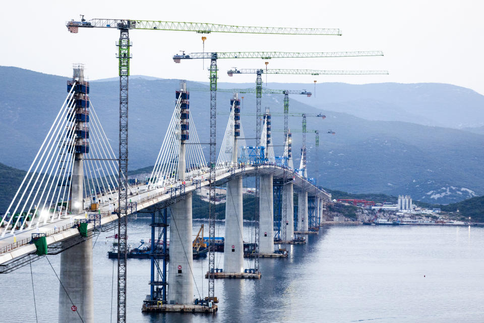 A view of the construction of the Peljesac Bridge in Komarna, Croatia, Wednesday, July 28, 2021. European Union-funded Peljesac Bridge in southern Croatia that has been built by a Chinese state-owned company was opened late Wednesday. The bridge was designed to connect two swaths of Adriatic Sea coastline and passes over a small stretch of Bosnia's territory. (AP Photo)