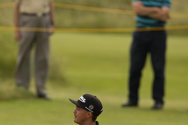 Rickie Fowler of the US stands in bunker by the 6th green during a practice round at Royal Liverpool Golf Club prior to the start of the British Open Golf Championship, in Hoylake, England, Monday, July 14, 2014. The 2014 Open Championship starts on Thursday, July 17. (AP Photo/Jon Super)
