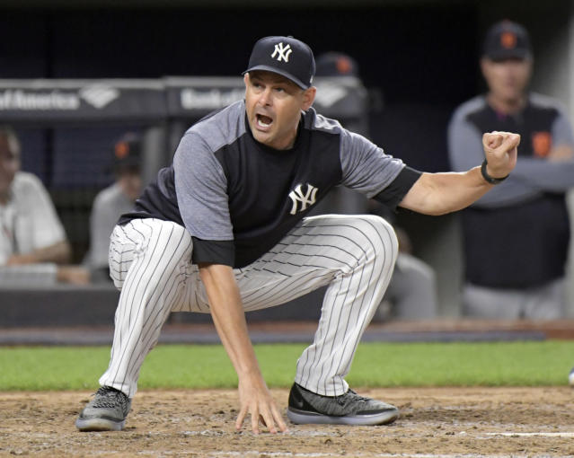 New York Yankees manager Aaron Boone demonstrates to home plate umpire Nic Lentz before being tossed from a baseball game against the Detroit Tigers during the fifth inning Friday, Aug. 31, 2018, at Yankee Stadium in New York. (AP Photo/Bill Kostroun)