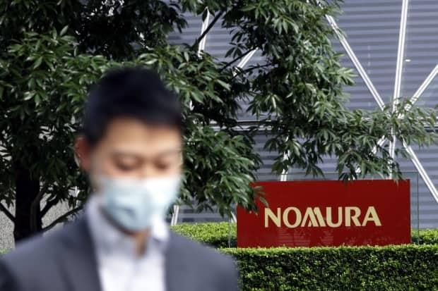 Shares in Nomura sold off by about 15 per cent after the Japanese bank revealed it was on the hook for about $2 billion in losses. (Kiyoshi Ota/Bloomberg - image credit)