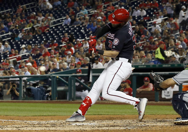 Washington Nationals' Bryce Harper hits a solo home run during the fifth inning of the team's baseball game against San Diego Padres at Nationals Park, Tuesday, May 22, 2018, in Washington. (AP Photo/Alex Brandon)