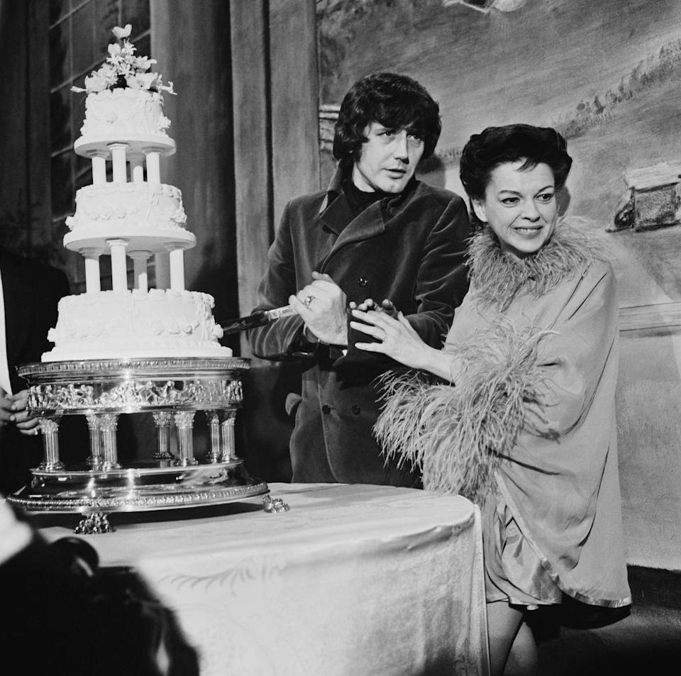 <p>Actress Judy Garland and businessman Mickey Deans smile for the crowd at their London wedding on March 15th, 1969. Garland tragically passed away a few months later and Deans never remarried.</p>