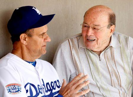 Los Angeles Dodgers head coach Torre talks to Garagiola Sr. before playing the Chicago White Sox in a MLB spring training game in Glendale