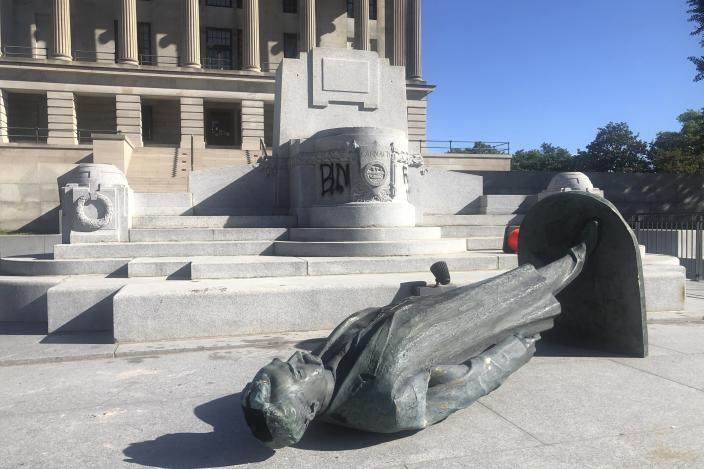 Protesters toppled the statue of Edward Carmack outside the state Capitol after a peaceful demonstration turned violent, Sunday, May 31, 2020, in Nashville, Tenn. (Kimberlee Kruesi/AP Photo)