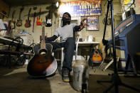 "Bluesman Jimmy ""Duck"" Holmes gestures as he speaks of the area musicians he learned the style of the Bentonia Blues from at his Blue Front Cafe in Bentonia, Miss., Jan. 21, 2021. Holmes' ninth album, ""Cypress Grove,"" has earned a Grammy nomination for the Best Traditional Blues Album. (AP Photo/Rogelio V. Solis)"