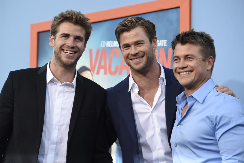 Liam Hemsworth, from left, Chris Hemsworth and Luke Hemsworth arrive at the Los Angeles premiere of