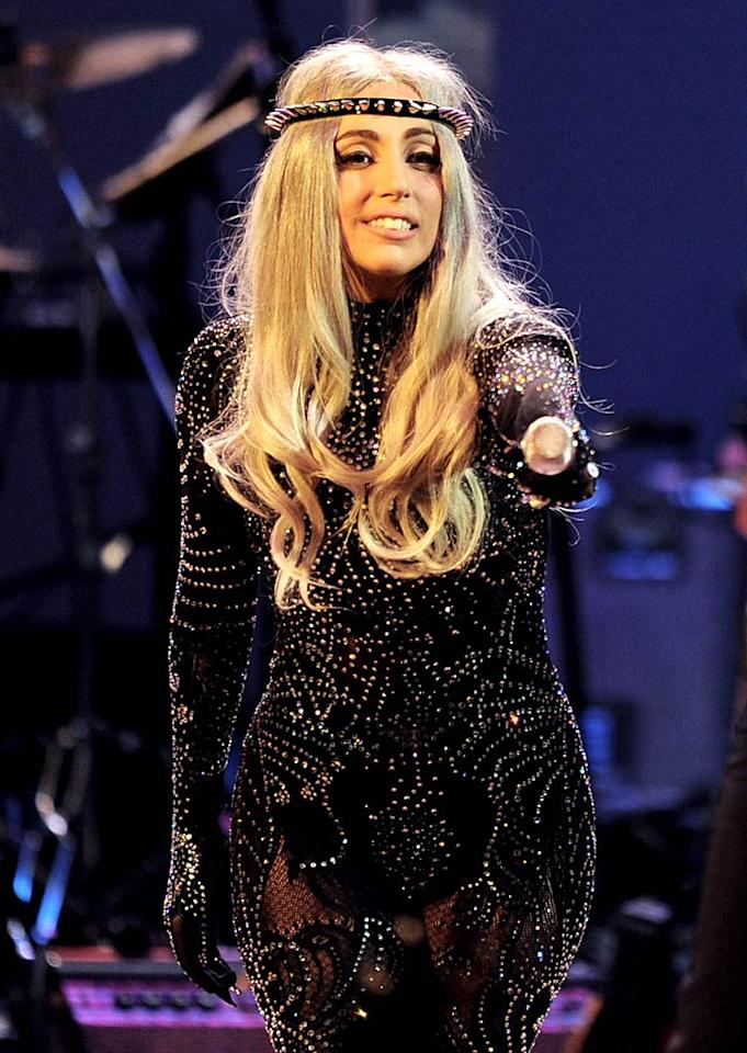"Perez Hilton reports Lady Gaga was recently in a London pub, The Raven, and asked a couple what they were celebrating. After the singer was told the two had just gotten married, Perez says Gaga announced, ""That calls for a song,"" and got a guy to play guitar as she serenaded the newlyweds with a rendition of The Rolling Stones' ""Gimme Shelter."" For all the details about Gaga the wedding singer, read what the manager of the pub leaks exclusively to <a href=""http://www.gossipcop.com/lady-gaga-singing-serenading-newlyweds-ewan-julie-searle-the-raven-london-pub/"" target=""new"">Gossip Cop</a>. Kevin Winter/<a href=""http://www.gettyimages.com/"" target=""new"">GettyImages.com</a> - October 2, 2010"