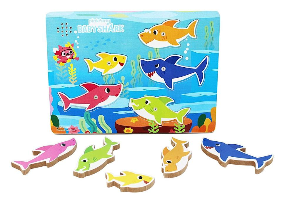 """<p>This <a href=""""https://www.popsugar.com/buy/Pinkfong-Baby-Shark-Puzzle-585248?p_name=Pinkfong%20Baby%20Shark%20Puzzle&retailer=amazon.com&pid=585248&price=15&evar1=moms%3Aus&evar9=45808433&evar98=https%3A%2F%2Fwww.popsugar.com%2Fphoto-gallery%2F45808433%2Fimage%2F45808444%2FLovely-Interactive-Puzzle&list1=toy%20fair%2Ckid%20shopping&prop13=api&pdata=1"""" class=""""link rapid-noclick-resp"""" rel=""""nofollow noopener"""" target=""""_blank"""" data-ylk=""""slk:Pinkfong Baby Shark Puzzle"""">Pinkfong Baby Shark Puzzle</a> ($15) sings when you fit the pieces in the correct spots.</p>"""