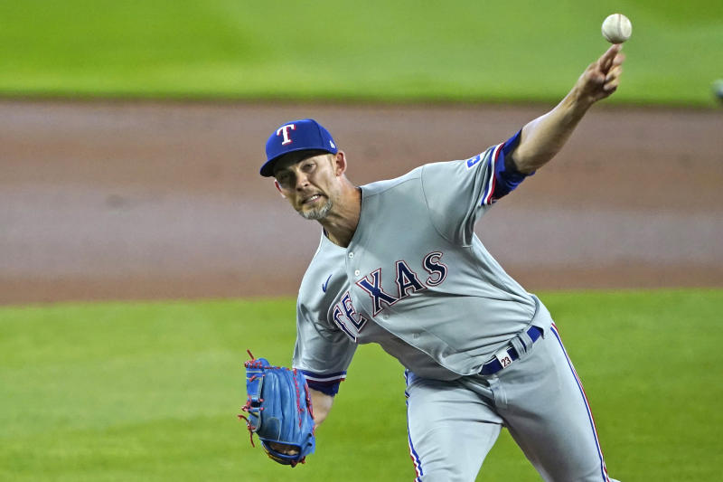 Texas Rangers starting pitcher Mike Minor throws against the Seattle Mariners during the first inning of a baseball game, Sunday, Aug. 23, 2020, in Seattle. (AP Photo/Ted S. Warren)