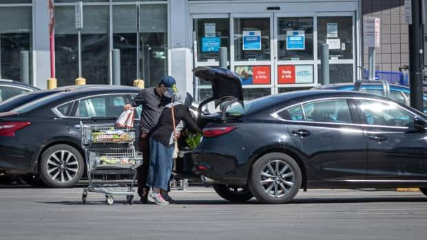 People load groceries into their vehicle in Ottawa on April 7, 2021. The next day, Ontario announced its latest stay-at-home order, in place until at least May 20. (Brian Morris/CBC - image credit)