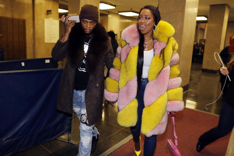 """Rapper Remy Ma, whose real name is Reminisce Smith, leaves Manhattan criminal court, with her husband Shamele Mackie, whose stage name is Papoose, in New York, Monday, Dec. 2, 2019. She's accused of punching her """"Love & Hip Hop New York"""" co-star Brittney Taylor in the face during an April 16 concert at Irving Plaza, in Manhattan. (AP Photo/Richard Drew)"""