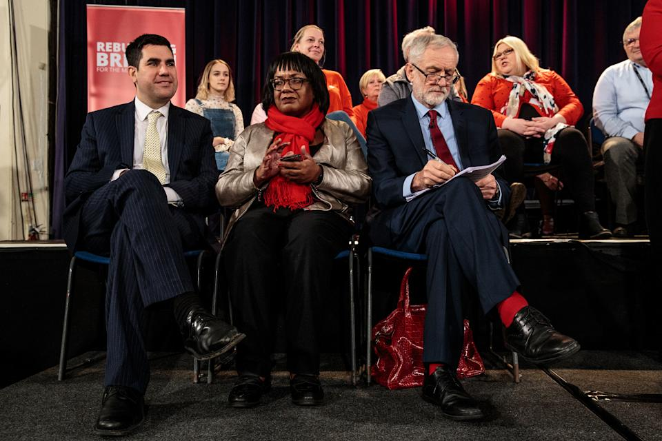 HASTINGS, ENGLAND - JANUARY 17: Labour Leader Jeremy Corbyn (R) sits next to Shadow Home Secretary Diane Abbott (C) Shadow Justice Secretary Richard Burgon (L) ahead of a speech at a rally at St Mary's in the Castle on January 17, 2019 in Hastings, England. British Prime Minister Theresa May last night won a vote of no-confidence called by Leader of the Opposition Jeremy Corbyn after the Government's historic defeat on the meaningful vote. (Photo by Jack Taylor/Getty Images)