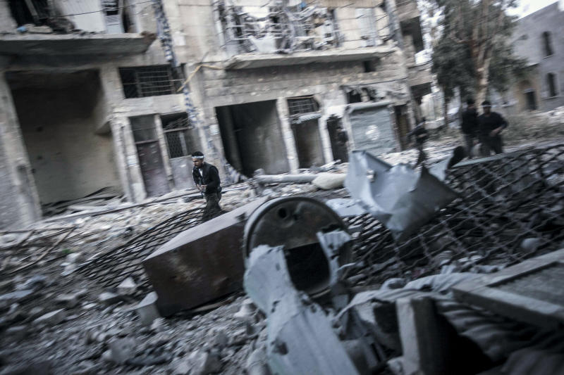 In this Thursday, Nov. 1, 2012 photo, rebel fighters run for cover at the front line during clashes in the Karmal Jabl battlefield in Aleppo, Syria. (AP Photo/Narciso Contreras)