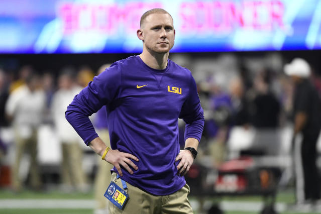 LSU offensive coach Joe Brady watches his team warm up before the Peach Bowl between LSU and Oklahoma. (AP)