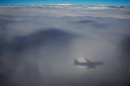 The shadow of Aeroflot Airbus A320 aircraft is seen on clouds during its flight from Rostov to Moscow, both host cities of the FIFA World Cup, Russia, July 3, 2018. REUTERS/Toru Hanai