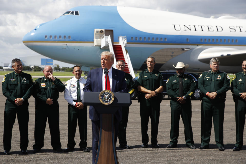 With Air Force One in the background, President Donald Trump speaks during a campaign event with Florida Sheriffs in Tampa, Fla., Friday, July 31, 2020. (AP Photo/Patrick Semansky)
