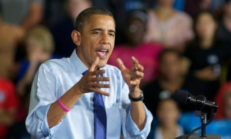 Obama speaks at a rally in Iowa on Oct. 17: The president and GOP challenger have been working overtime to spin their performances during the second presidential debate on Tuesday.