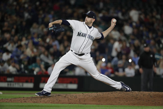 Seattle Mariners starting pitcher James Paxton throws to a Detroit Tigers batter during the ninth inning of a baseball game, Saturday, May 19, 2018, in Seattle. Paxton threw a three-hitter as the Mariners won 7-2. (AP Photo/Ted S. Warren)