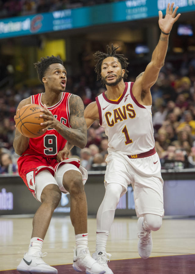 Chicago Bulls' Antonio Blakeney (9) prepares to shoot past Cleveland Cavaliers' Derrick Rose (1) during the first half of an NBA preseason basketball game in Cleveland, Tuesday, Oct. 10, 2017. (AP Photo/Phil Long)