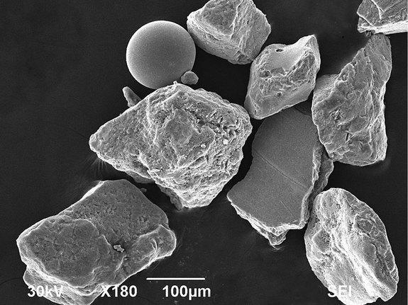 Geologists found angular, metallic fragments within sand from Omaha Beach, which they believe to be the remnants of shrapnel. They also found iron and glass beads, which they believe were created by the heat of mortar explosions. Above, a scann