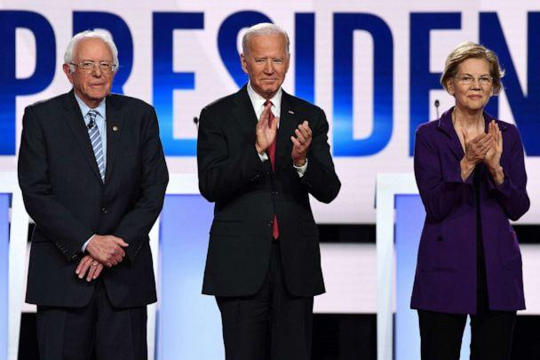 PHOTO: In this file photo taken on Oct. 15, 2019, Democratic presidential hopefuls Senator Bernie Sanders, former US Vice President Joe Biden and Senator Elizabeth Warren arrive onstage for the Democratic primary debate at in Westerville, Ohio. (Saul Loeb/AFP via Getty Images, FILE)