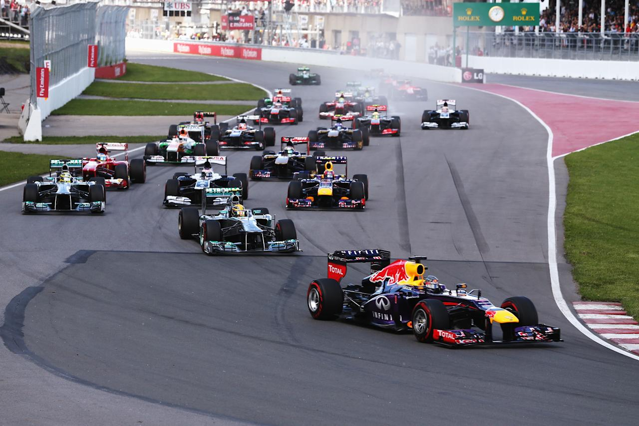MONTREAL, QC - JUNE 09:  Sebastian Vettel of Germany and Infiniti Red Bull Racing leads the field into turn one at the start of the Canadian Formula One Grand Prix at the Circuit Gilles Villeneuve on June 9, 2013 in Montreal, Canada.  (Photo by Mark Thompson/Getty Images)