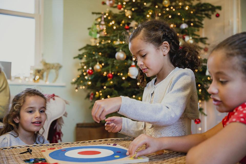 "<p>For some families, <a href=""https://www.goodhousekeeping.com/holidays/christmas-ideas/"" rel=""nofollow noopener"" target=""_blank"" data-ylk=""slk:Christmas"" class=""link rapid-noclick-resp"">Christmas</a> can feel like more of a marathon than a sprint. Sure, there's opening the gifts (browse our favorite <a href=""https://www.goodhousekeeping.com/holidays/gift-ideas/"" rel=""nofollow noopener"" target=""_blank"" data-ylk=""slk:gift ideas"" class=""link rapid-noclick-resp"">gift ideas</a>!), preparing and enjoying the big <a href=""https://www.goodhousekeeping.com/holidays/christmas-ideas/g4019/best-christmas-hams/"" rel=""nofollow noopener"" target=""_blank"" data-ylk=""slk:Christmas ham"" class=""link rapid-noclick-resp"">Christmas ham</a>, and then cleaning up afterward, but once you've eaten the figgy pudding and put away the dishes, it can be tough to find ways to occupy the crew. Let's get real here, there are only so many <a href=""https://www.goodhousekeeping.com/holidays/christmas-ideas/g1315/best-christmas-movies/"" rel=""nofollow noopener"" target=""_blank"" data-ylk=""slk:Christmas movies"" class=""link rapid-noclick-resp"">Christmas movies</a> you can watch (and no one really wants to hear the same story Uncle Joe always tells for the hundredth time). And if you have overnight guests with young kids that need to be kept occupied, you're going to need some activities in your back pocket to stave off the inevitable, ""I'm bored!"" </p><p>The solution? These fun Christmas games. Engage your family and friends in a little competition to get everyone's adrenaline pumping and keep the post-holiday doldrums at bay. Best of all, many of these activities involve crafting or DIY, so the games are just as much fun to make as to play. You'll definitely want to set aside some time during the <a href=""https://www.goodhousekeeping.com/holidays/christmas-ideas/"" rel=""nofollow noopener"" target=""_blank"" data-ylk=""slk:Christmas season"" class=""link rapid-noclick-resp"">Christmas season</a> for these holiday games for kids and adults. </p>"