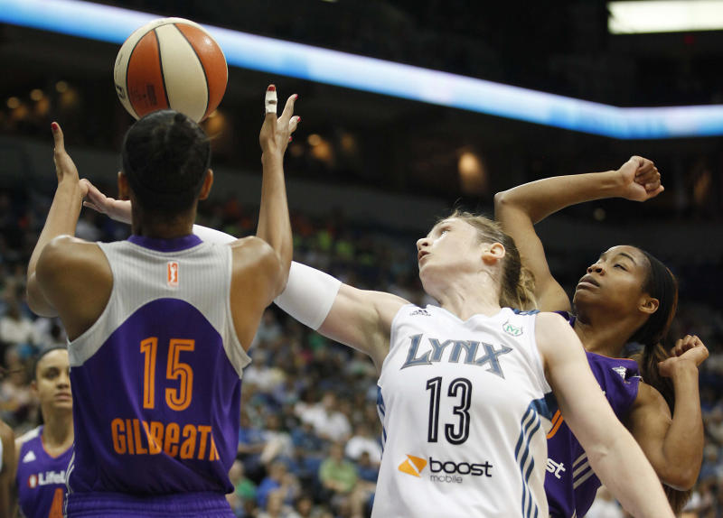 Minnesota Lynx guard Lindsay Whalen (13) tries to grab a rebound against Phoenix Mercury guard Briana Gilbreath (15) in the first half of a WNBA basketball game, Wednesday, July 24, 2013, in Minneapolis. (AP Photo/Stacy Bengs)