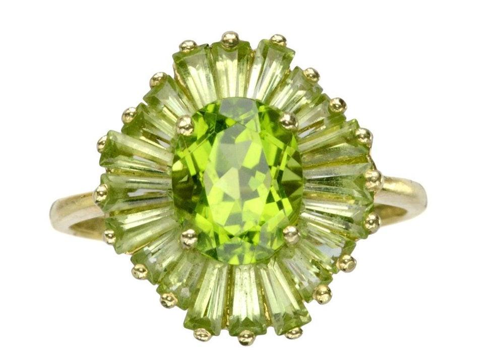 """<br><br><strong>Vintage</strong> Peridot Ballerina Ring, $, available at <a href=""""https://go.skimresources.com/?id=30283X879131&url=https%3A%2F%2Feriebasin.com%2Fproducts%2F1980s-peridot-ballerina-ring"""" rel=""""nofollow noopener"""" target=""""_blank"""" data-ylk=""""slk:Erie Basin"""" class=""""link rapid-noclick-resp"""">Erie Basin</a>"""