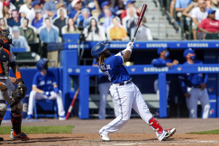 Toronto Blue Jays' Vladimir Guerrero Jr. (27) watches his two-run home run sail over the wall during the fifth inning of a baseball game against the Houston Astros in Buffalo, N.Y., Saturday, June 5, 2021. (AP Photo/Joshua Bessex)