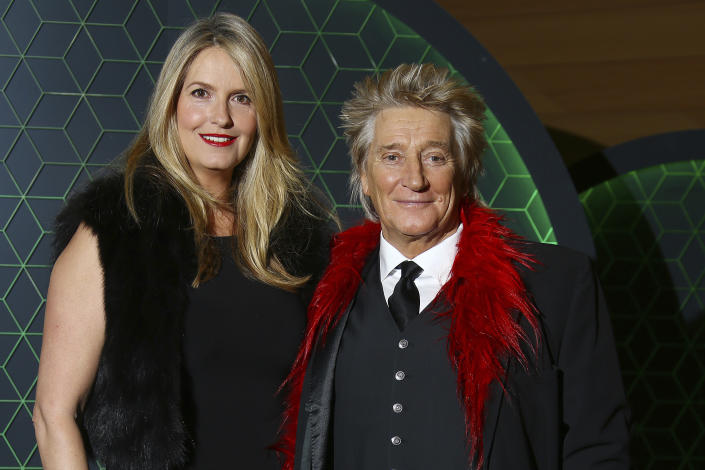 Penny Lancaster and Rod Stewart pose for photographers upon arrival at the Bloomberg and Vanity Fair Gala Dinner in central London, Tuesday, Dec. 11, 2018. (Photo by Joel C Ryan/Invision/AP)