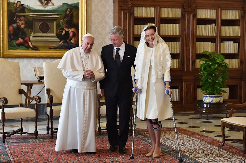 Pope Francis speaks with King Philippe of Belgium and Queen Mathilde during a private audience on March 9, 2015 at the Vatican