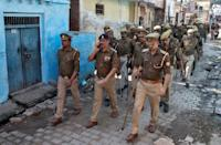 Police officers patrol an alley after Supreme Court's verdict on a disputed religious site in Ayodhya, India, November 9, 2019. REUTERS/Danish Siddiqui