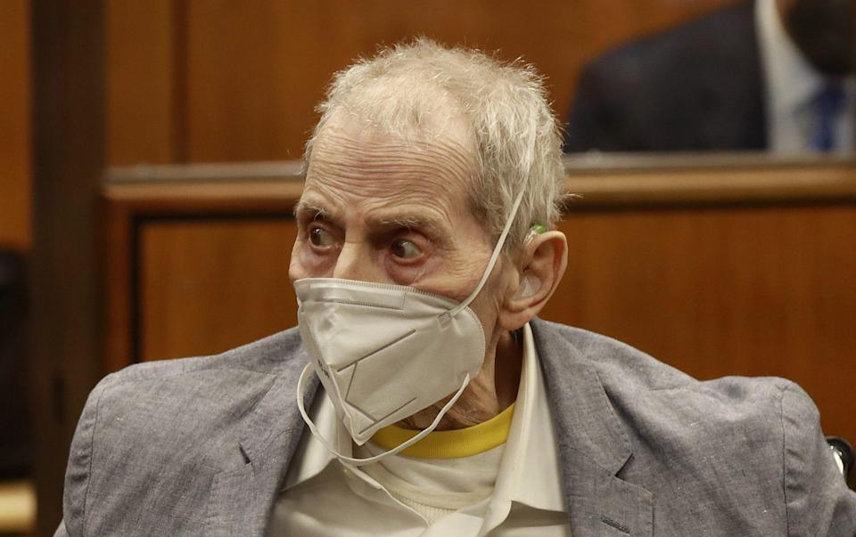 Robert Durst in his wheelchair spins in place as he looks at people in the courtroom as he attends the closing arguments in his murder trial at the Inglewood Courthouse in Inglewood, California - Shutterstock