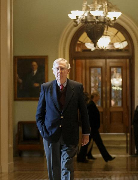 Senate Minority Leader Mitch McConnell of Ky. returns to his Capitol Hill office in Washington, Monday, Feb. 3, 2014, after speaking on the floor as the Farm Bill is considered. (AP Photo/J. Scott Applewhite)
