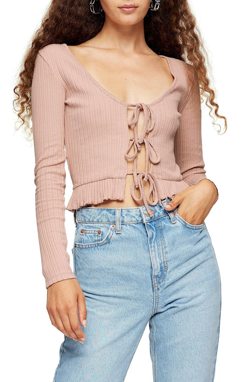 <p>This sultry <span>Topshop Lace-Up Crop Cardigan</span> ($30) shows just the right amount of skin.</p>