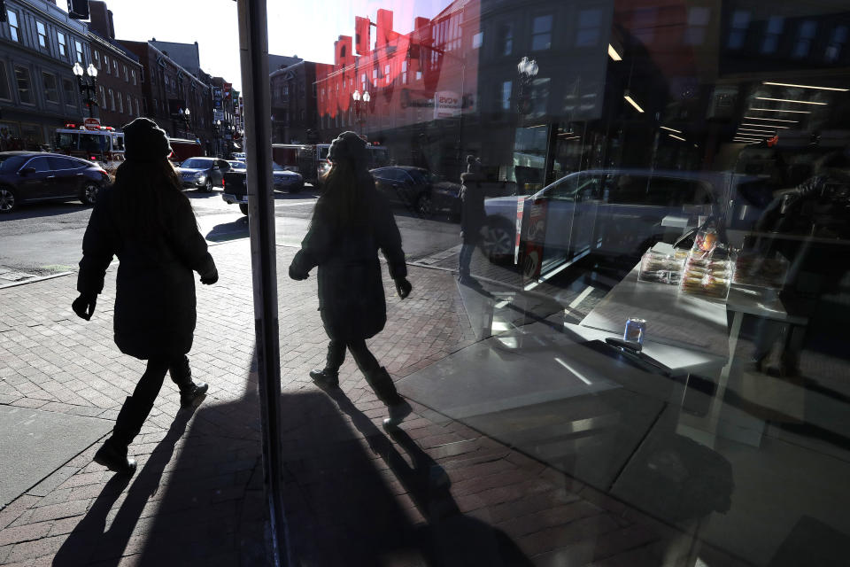 In this Jan. 9, 2020 photo a passer-by is reflected in the glass of a storefront in the Harvard Square neighborhood, of Cambridge, Mass. Recessions, and their severity, are out of your control, but as Luke Delorme, director of financial planning at American Investment Services and others point out, your own financial situation doesn't have to be. You can take steps to insulate yourself from an economic downturn. (AP Photo/Steven Senne)