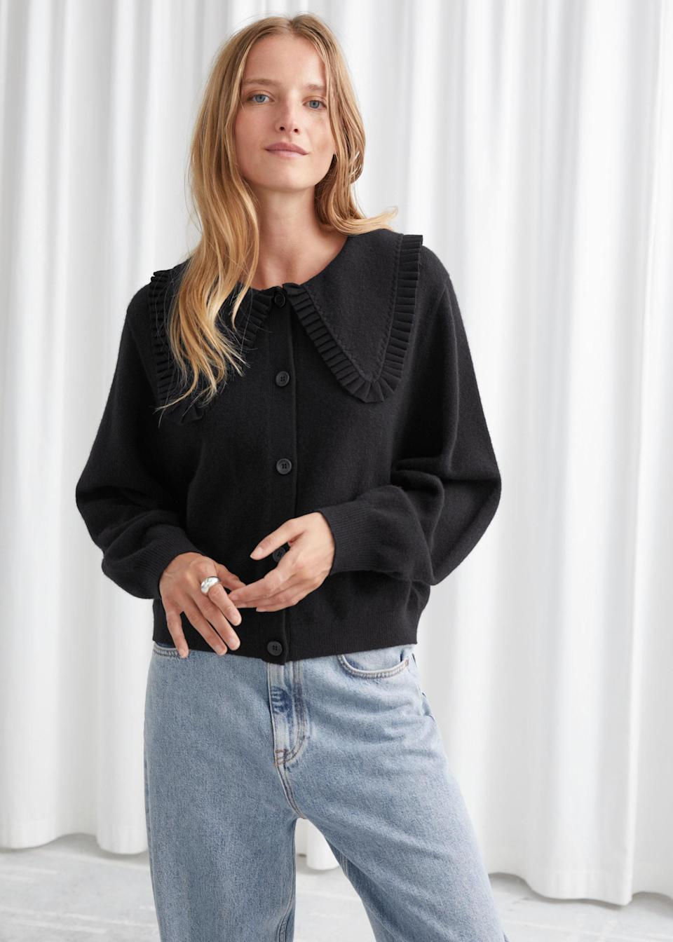 """Yes, you can stay low-key. $129, & Other Stories. <a href=""""https://www.stories.com/en_usd/clothing/knitwear/cardigans/product.statement-collar-wool-knit-cardigan-black.0902688001.html"""" rel=""""nofollow noopener"""" target=""""_blank"""" data-ylk=""""slk:Get it now!"""" class=""""link rapid-noclick-resp"""">Get it now!</a>"""