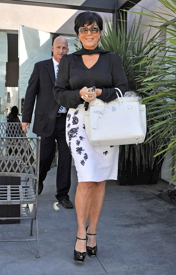 """Family matriarch Kris Jenner was all smiles while exiting out the back door of the bridal shop. Fern/<a href=""""http://www.splashnewsonline.com/"""" target=""""new"""">Splash News</a> - August 17, 2011"""