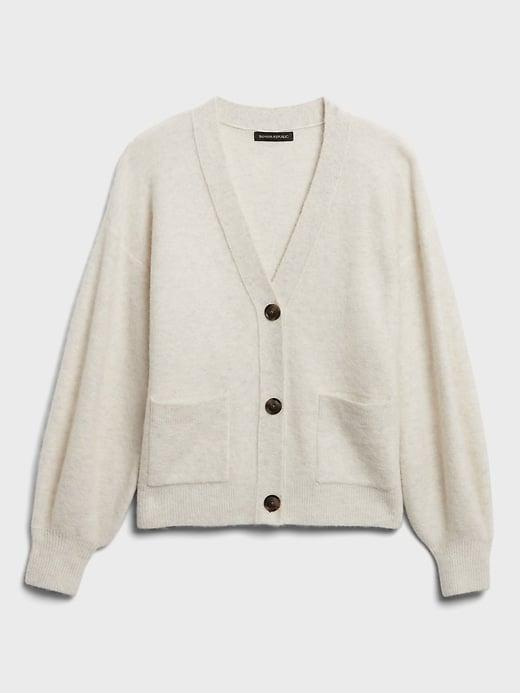 <p>Or try this <span>Banana Republic Oversized Blouson-Sleeve Cardigan Sweater</span> ($29, originally $99) with trendy blouson sleeves. The recycled polyester, wool and alpaca are sure to keep you extra warm and soft!</p>