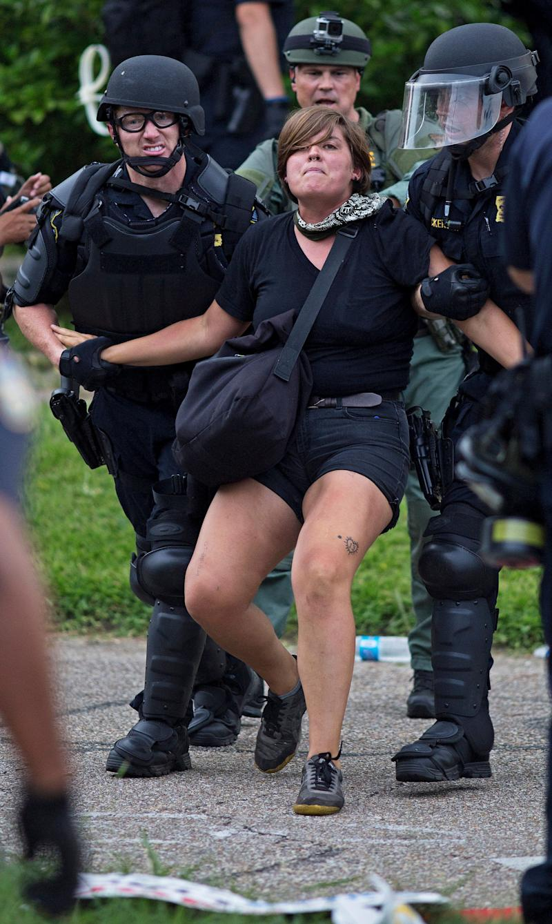 Police arrest protesters after dispersing crowds in a residential neighborhood in Baton Rouge, La. on Sunday, July 10, 2016. After an organized protest in downtown Baton Rouge protesters wondered into residential neighborhoods and toward a major highway that caused the police to respond by arresting protesters that refused to disperse. (AP Photo/Max Becherer)