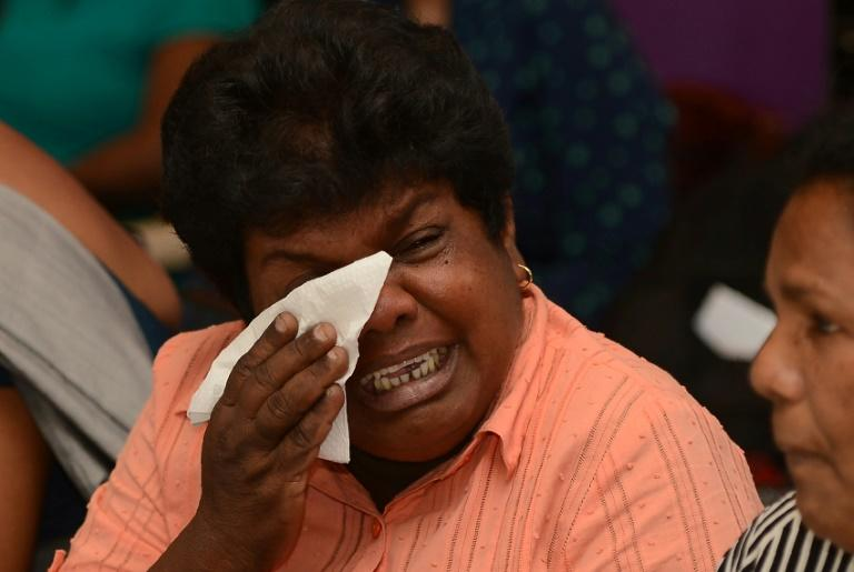 A relative of one of the eight Sri Lankan crewmen taken hostage by Somali pirates, cries as she pleads for his release during a press conference in Colombo, on March 16, 2017