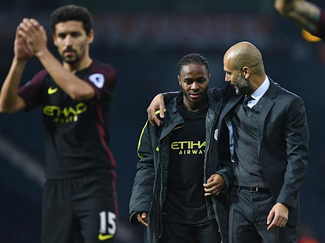 Guardiola with City and England youngster Sterling: Getty