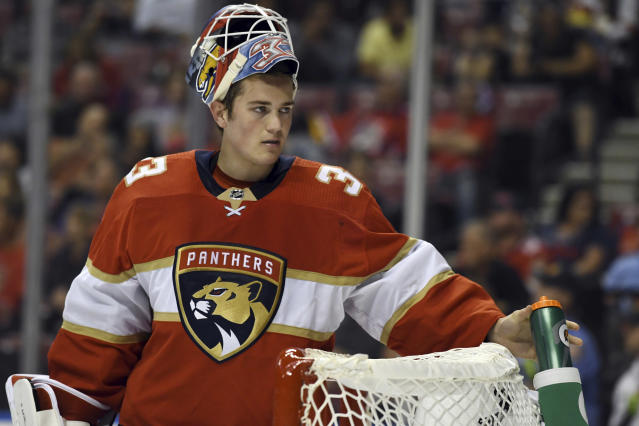 Florida Panthers goaltender Sam Montembeault (33) takes a break during a timeout in the second period of an NHL hockey game against the Carolina Hurricanes, Tuesday, Oct. 8, 2019, in Sunrise, Fla. (AP Photo/Jim Rassol)
