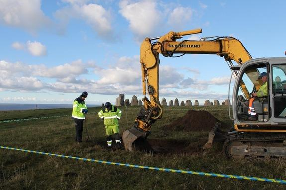 A 5,500-year-old tomb possibly belonging to a Stone Age chieftain has been unearthed at a megalithic monument in the shape of a ship called the Ale's Stenar (Ale's Stones). Here, archaeologist Björn Wallebom clears the northern brim of the dolm