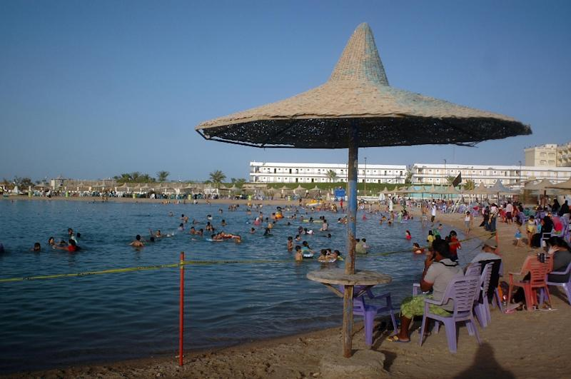 Egyptians enjoy the beach along the Red Sea resort of Hurghada on June 23, 2010 (AFP Photo/)