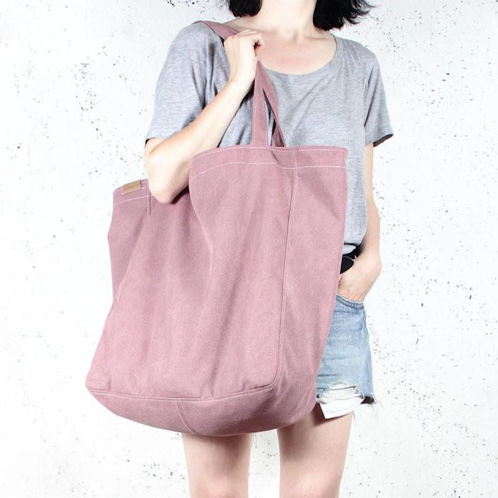 """<strong>Get the <a href=""""https://www.etsy.com/listing/171109666/big-lazy-bag-pink-shoulder-rouge-tote"""" rel=""""nofollow noopener"""" target=""""_blank"""" data-ylk=""""slk:Hairoo Big &quot;Lazy Bag&quot; in organic cotton"""" class=""""link rapid-noclick-resp"""">Hairoo Big """"Lazy Bag"""" in organic cotton</a> for $60</strong>"""