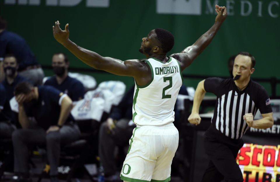 Oregon forward Eugene Omoruyi (2) celebrates after making a three-point basket against Arizona during the first half of an NCAA college basketball game Monday, March 1, 2021, in Eugene, Ore. (AP Photo/Andy Nelson)