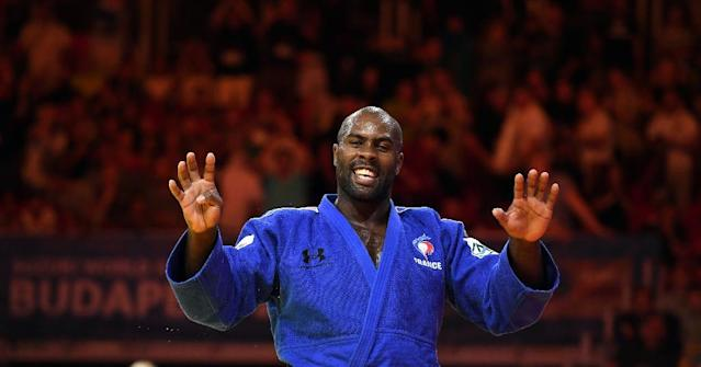 France's Teddy Riner celebrates after winning the men's +100kg category at the World Judo Championships in Budapest (AFP Photo/ATTILA KISBENEDEK)